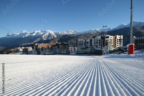fototapeta na ścianę Winter view of the mountains and hotels in the ski resort Rosa Khutor, Sochi, Russia.