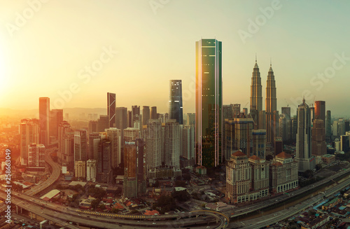Future 3d modern neon light design skyscraper mix in sunrise Kuala Lumpur city skyline , future vision of modern city , mixed media .