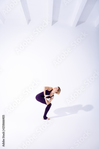 canvas print picture Beautiful slim woman having a yoga lesson
