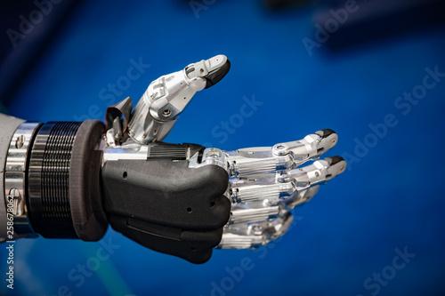 Leinwandbild Motiv Futuristic Robotic Hand for a handshake