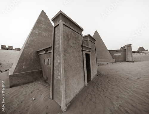 Black and white wide-angle shot of a completely renovated, restored and refurbished pyramid in Meroe, Sudan. © Frank