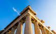 View of corner of Parthenon and its columns on Acropolis, Athens, Greece against blue sky