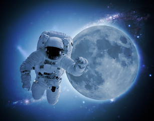 astronaut levitate in space in front of moon. elements of this images furnished by nasa
