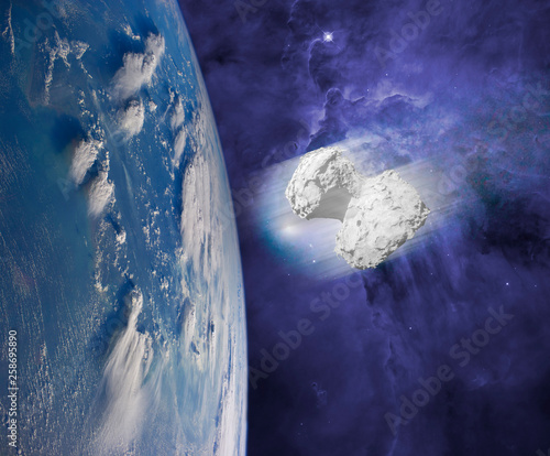 asteroid comet or meteor coming to the earth.  elements of this images furnished by nasa - 258695890