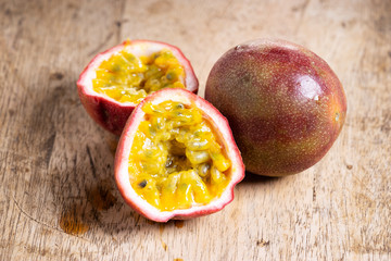 Ripe passion fruit on wooden background