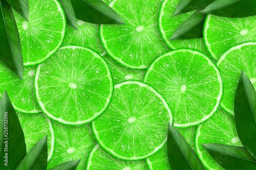 Leinwandbild Motiv Sliced juicy lime. Close-up. Copy space. Fresh fruits. Fruit background.