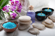 composition of the spa treatment. Candles in bowls with water, bath salts, and orchid flowers. - 258716094