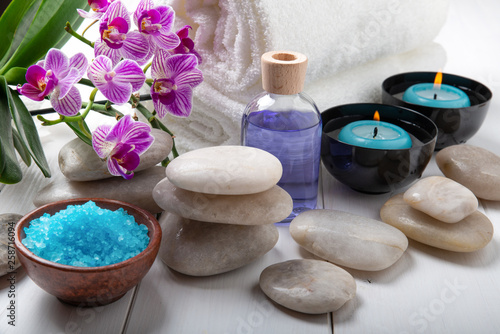 composition of the spa treatment. Candles in bowls with water, bath salts, and orchid flowers. © luigi giordano