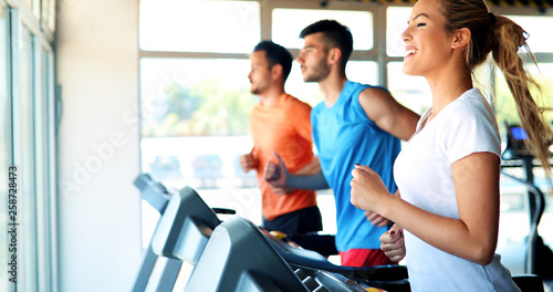 Leinwandbild Motiv Young attractive woman doing cardio training in gym