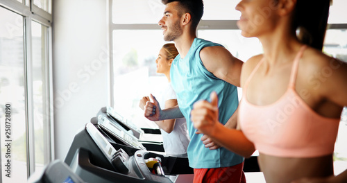 Picture of people running on treadmill in gym © nd3000