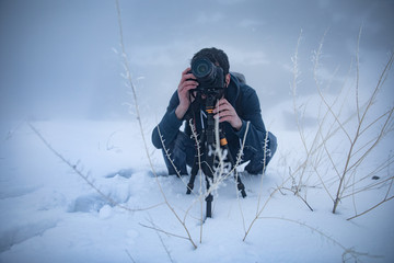 photographer hand camera in winter