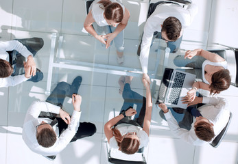 top view.handshake of employees at the working meeting.