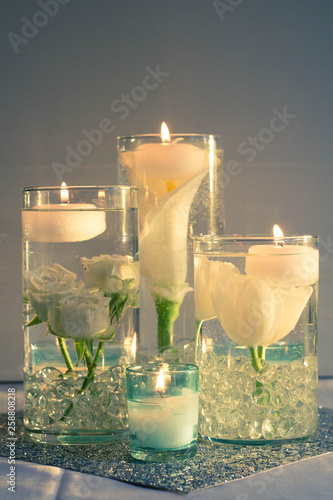 Floating candles and roses in water at a wedding © Shalese