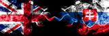 United Kingdom vs Slovakia, Slovakian smoky mystic flags placed side by side. Thick colored silky smoke flags of Great Britain and Slovakia, Slovakian.