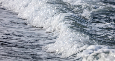 Waves on the seashore as an abstract background