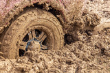 Car wheel slips in the dirt in nature