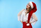 Cute pretty woman in Christmas Santa hat