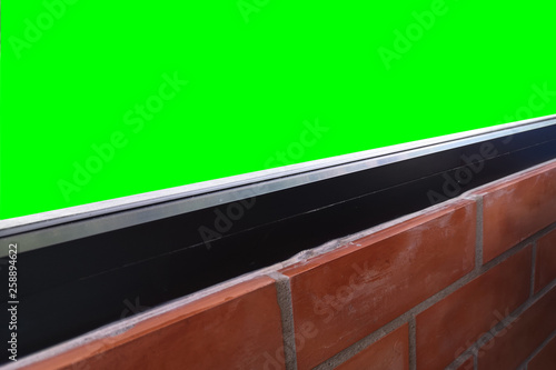 Window glass .View inside the room decorated with red brick and green screen Isolated on background with clipping path.that the space for its shows. - 258894622
