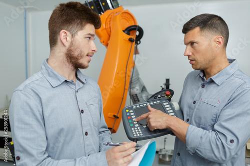 Leinwandbild Motiv two mechanical engineers