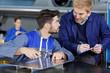 Leinwandbild Motiv apprentice aerospace engineer asking tutor a question