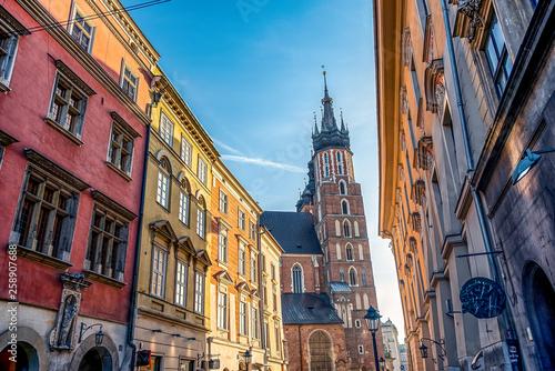 17/02/2019 Krakow, Poland, tourists walking along the main pedestrian Florianska street of city on a sunny day