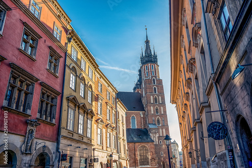 fototapeta na ścianę 17/02/2019 Krakow, Poland, tourists walking along the main pedestrian Florianska street of city on a sunny day