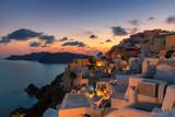 Santorini at sunset. Amazing sunset view in Oia village on Santorini island, Greece.