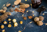 Chocolate muffin, popcorn and walnuts. Christmas composition with fir cones. Top view and flat lay.