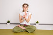 Female model in yoga pose in the studio. Young woman doing exercises. Relax.