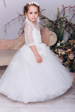 Cute adorable baby girl in elegant wedding dress indoors posing and looking at camera. Childhood, fashion kids concept