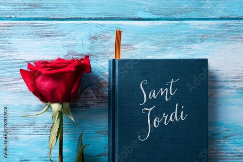 rose, catalan flag, book and text Sant Jordi.