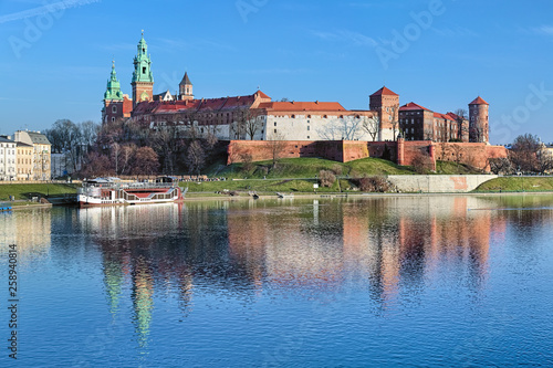 Wawel Hill with Wawel Royal Castle and Wawel Cathedral in Krakow, Poland. View from Debnicki bridge across Vistula river.