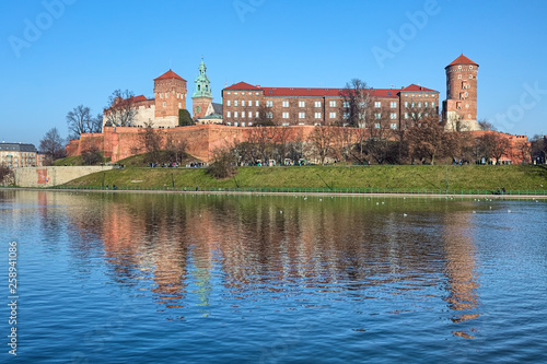 Wawel Hill with Wawel Royal Castle and Wawel Cathedral in Krakow, Poland. View from the bank of Vistula river.