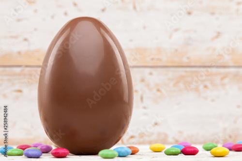 fototapeta na ścianę Chocolate Easter holiday egg on rustic backround