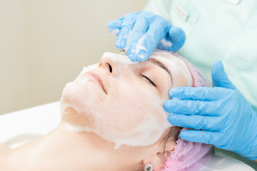 Process cosmetic mask of massage and facials in beauty salon  © lester120