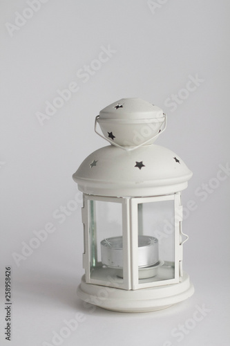 Stand for setting candles on a white background © Yuliya Loginova