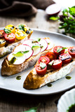 Bruschetta with Cherry Tomatoes and Radish with Basil oil,