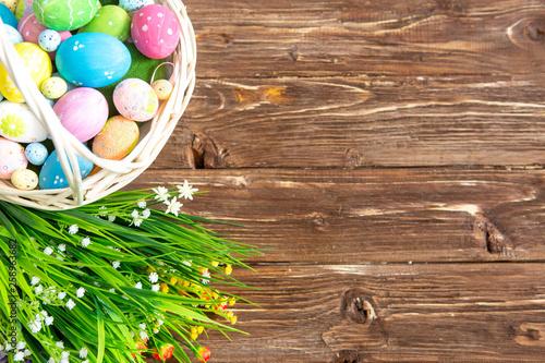 Easter eggs in the basket of wooden boards © Alik Mulikov