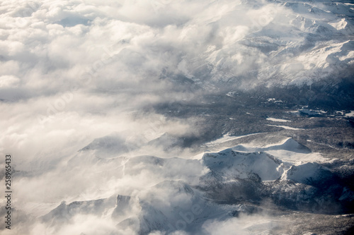 High aerial view of the Sierra Nevada Mountains of California during the heavy snowfall season