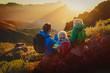 Leinwandbild Motiv father and two kids travel in mountains, family hiking