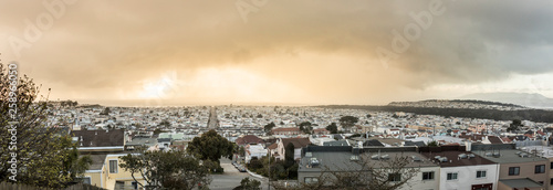 View of the Sunset District of San Francisco as a rain storm moves in at sunset