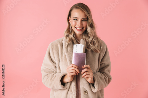 canvas print picture Beautiful young blonde woman wearing winter fur coat
