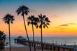 Leinwandbild Motiv Sunset at California beach, Manhattan Beach, Los Angeles, USA.