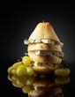 Leinwandbild Motiv Blue cheese with pear, thyme and grapes.