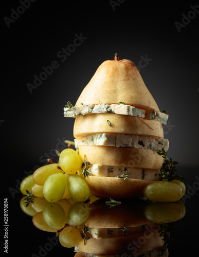 Blue cheese with pear, thyme and grapes. - 258978894