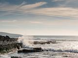 Wave crushing on rocks creating splash, West coast of Ireland. County Clare.