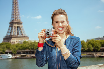 solo traveller woman taking photos with retro photo camera