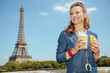 solo traveller woman with coffee cup and croissant having excurs