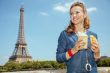 Fototapeta Fototapety z wieżą Eiffla - solo traveller woman with coffee cup and croissant having excurs © Alliance