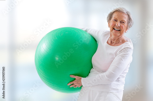 Senior Woman with fitness ball in gym. © JPC-PROD